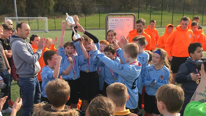 College students help primary school team to cup glory