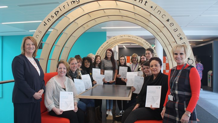 NHS workers complete college course
